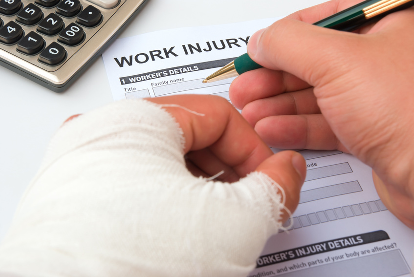 Injured worker fills out Workman's compensation form at Rush and Nicholson